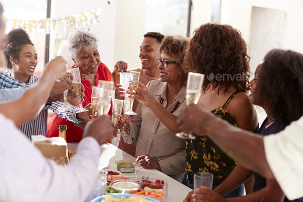 Three generation family celebrating together making a toast to grandmother,selective focus - Stock Photo - Images