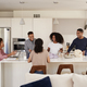 Black family in their kitchen talking and preparing a family meal together - PhotoDune Item for Sale
