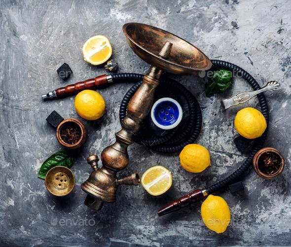 Smoking hookah with lemon flavor - Stock Photo - Images