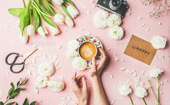 Coffee in female hands, flowers, film camera and sign happy - Stock Photo - Images
