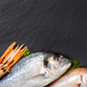 Fresh fish and seafood on dark vintage board - PhotoDune Item for Sale