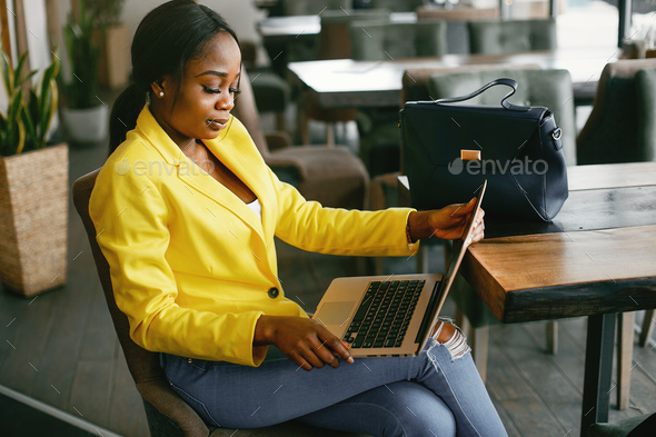 Stylish businesswoman working in a office - Stock Photo - Images