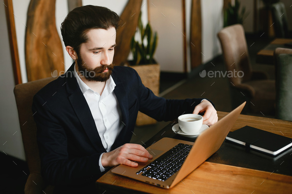 Stylish businessman working in a office - Stock Photo - Images