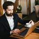 Stylish businessman working in a office - PhotoDune Item for Sale