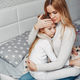Mother with her illnes daughter in a bedroom - PhotoDune Item for Sale