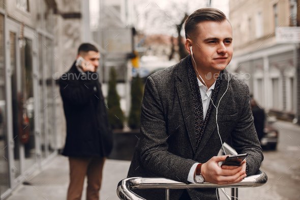 Two businessmen working with a phone - Stock Photo - Images