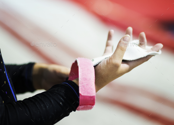 Young gymnast wearing a grip bar to her palm - Stock Photo - Images