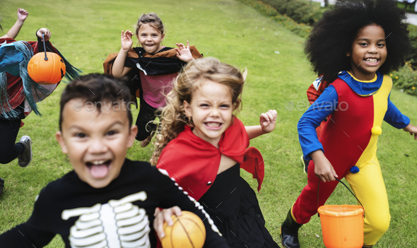 Little kids at a Halloween party - Stock Photo - Images
