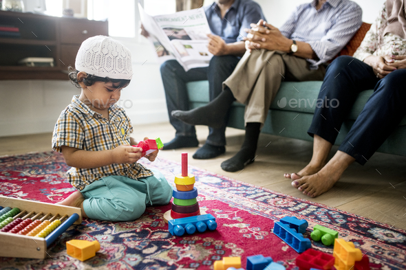 Muslim family relaxing and playing at home - Stock Photo - Images