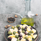 homemade potato salad with green and black olives, in gray rustic setting - PhotoDune Item for Sale