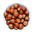 Hazelnuts with shell in bowl isolated on white background - PhotoDune Item for Sale