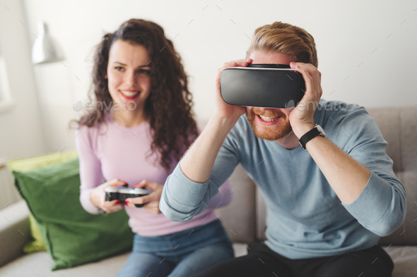 Couple enjoying VR and playing games - Stock Photo - Images