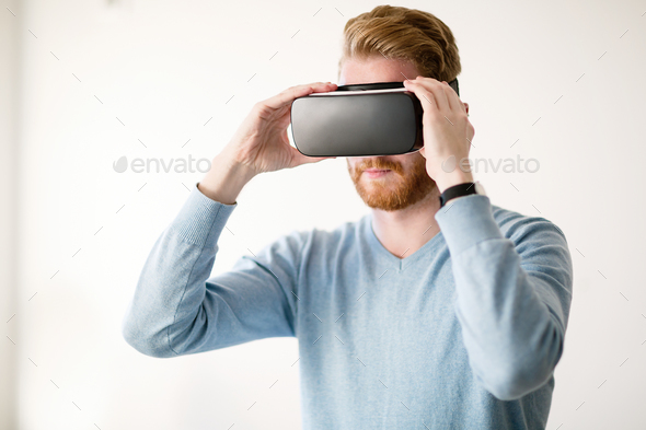 Man wearing future technology VR glasses - Stock Photo - Images