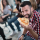 Coworkers eating pizza during break at office - PhotoDune Item for Sale