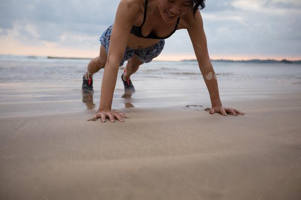 Push up on beach - Stock Photo - Images