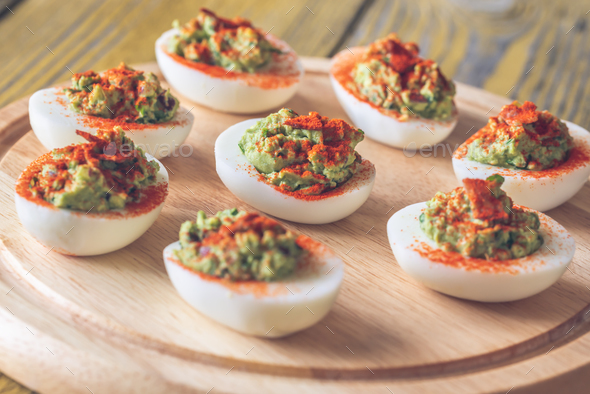 Guacamole and bacon deviled eggs - Stock Photo - Images