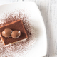 Portion of tiramisu on the white plate - PhotoDune Item for Sale