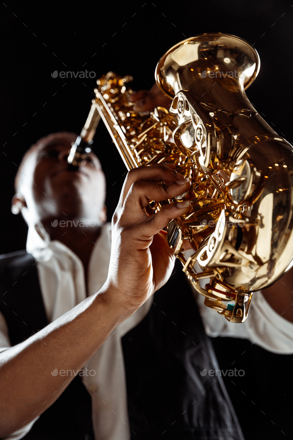 African American jazz musician playing the saxophone. - Stock Photo - Images