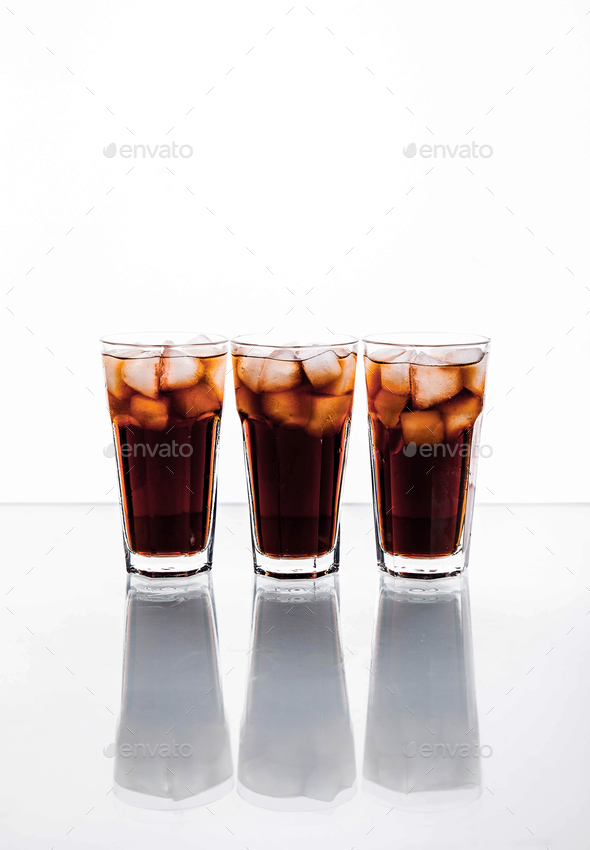 three glasses of cola and ice on a white background. soft drinks - Stock Photo - Images