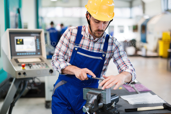 industrial factory employee working in metal manufacturing industry - Stock Photo - Images