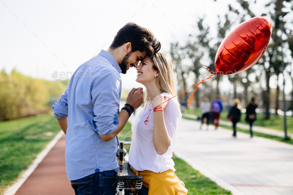 young couple hugging dating and kissing outdoor - Stock Photo - Images