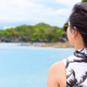 Woman tourist looking at the sea in Thailand - PhotoDune Item for Sale