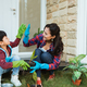 mother and son highfive while gardening together at home - PhotoDune Item for Sale