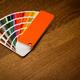 multicolor color paper sampler open on brown wooden floor - PhotoDune Item for Sale