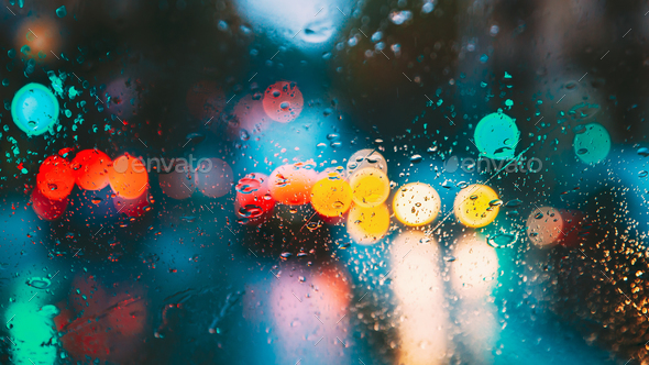 Drops Of Rain Water In Night Or Evening Street Lights On Blue Gl - Stock Photo - Images