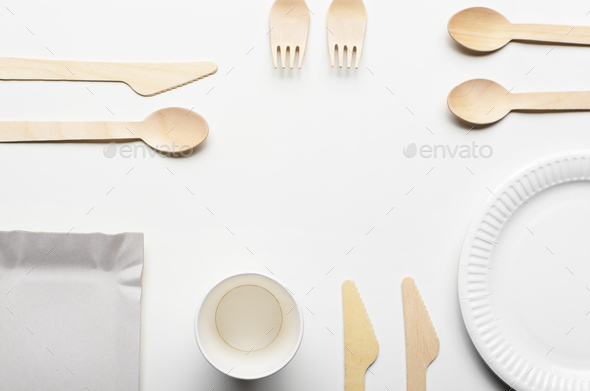 Wooden single use kitchenware and paper cups and plates on white - Stock Photo - Images