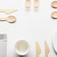 Wooden single use kitchenware and paper cups and plates on white - PhotoDune Item for Sale
