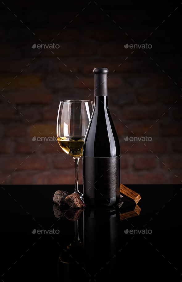 Glass of wine and wine bottle. - Stock Photo - Images