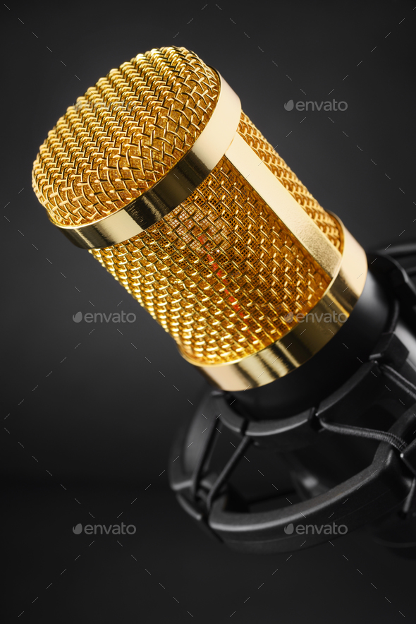 Gold condenser microphone on black - Stock Photo - Images
