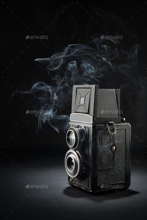 Old medium format camera on black - Stock Photo - Images