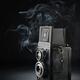 Old medium format camera on black - PhotoDune Item for Sale