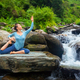 Sorty fit woman doing yoga asana outdoors at tropical waterfall - PhotoDune Item for Sale