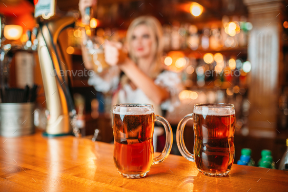 Two glasses of fresh beer on counter, octoberfest - Stock Photo - Images