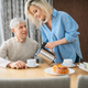 Mature wife treats husband to breakfast at home - PhotoDune Item for Sale