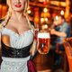 Sexy waitress with large breasts in pub - PhotoDune Item for Sale