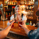 Two friends takes beer from waitress, oktoberfest - PhotoDune Item for Sale