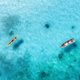 Aerial view of the fishing boats in clear blue water - PhotoDune Item for Sale