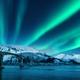 Bridge and aurora borealis over snowy mountains at night - PhotoDune Item for Sale