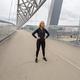 Beautiful Woman Athlete Standing At Modern Bridge In City - PhotoDune Item for Sale