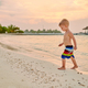 Three year old toddler boy on beach at sunset - PhotoDune Item for Sale