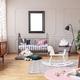White wooden rocking horse on patterned carpet - PhotoDune Item for Sale