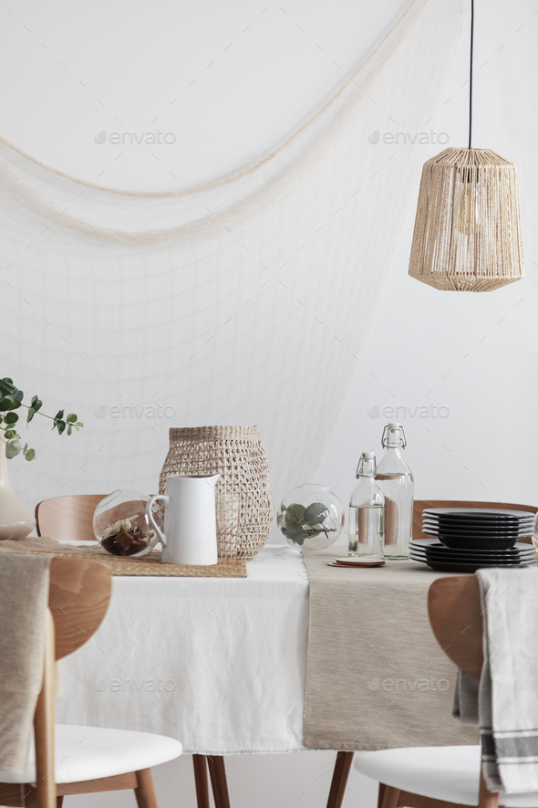 Rattan lamp above table in rustic dining room - Stock Photo - Images