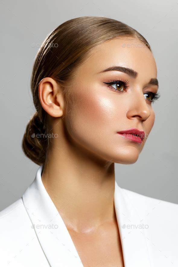 beautiful dark blonde girl in white jacket - Stock Photo - Images