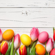 Fresh colorful tulips and easter eggs on wooden background - PhotoDune Item for Sale