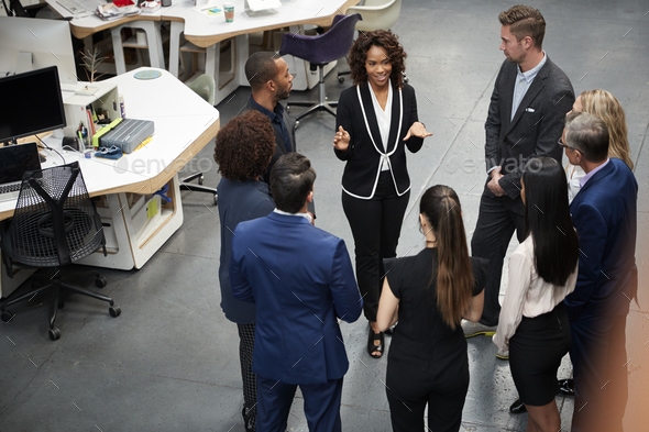 Business Team Standing Having Informal Meeting In Modern Office - Stock Photo - Images