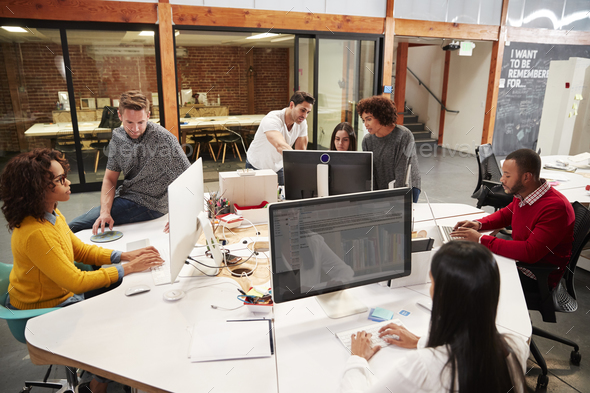 Casually Dressed Business Team Working At Desks In Modern Open Plan Office - Stock Photo - Images